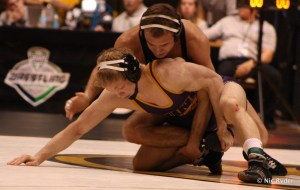 UNI's Dylan Peters works from the bottom position against Alan Waters in the MAC Championship