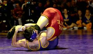 Joey Lazor hits a spladle on ISU's Gabe Moreno for a win by pinfall at a dual in 2014. Picture curtesy of UNI Athletics