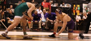 UNI's Curt Maas looks for an opening against Oho's Cody Walters at the 2014 MAC Championship