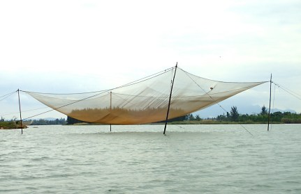 Fishing net on the Hoian River, Hoi An, Vietnam