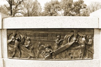 Bas-relief of women working on airplanes