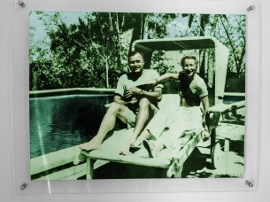 Ernest Hemingway, 4th wife Mary Walsh, and cat beside the pool