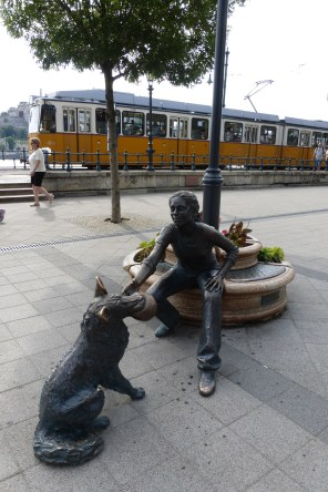Girl With Her Dog statue - and tram #2