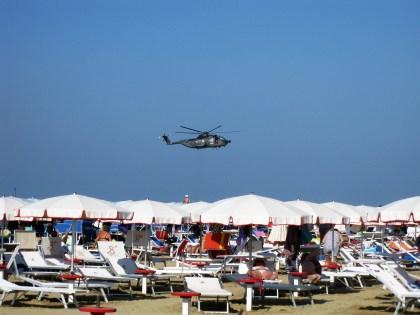 Rimini beach during an air show.