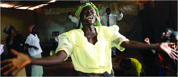 October 19, 2003, Mulungu-Lungu, Congo: Women sing and pray fervently at the revivalist Victory Church of Congo in Mulungu-Lungu. Pentacostal churches in Congo often perform exorcisms for people believed to possessed by the devil.. Credit: Evelyn Hockstein / Polaris