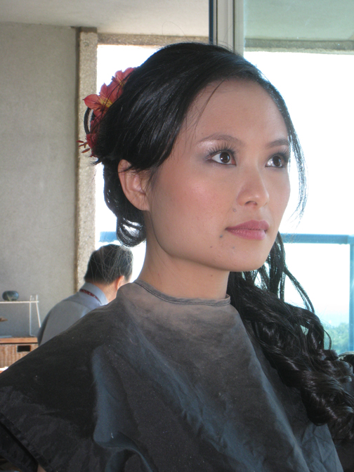 Makeup is done on the bride