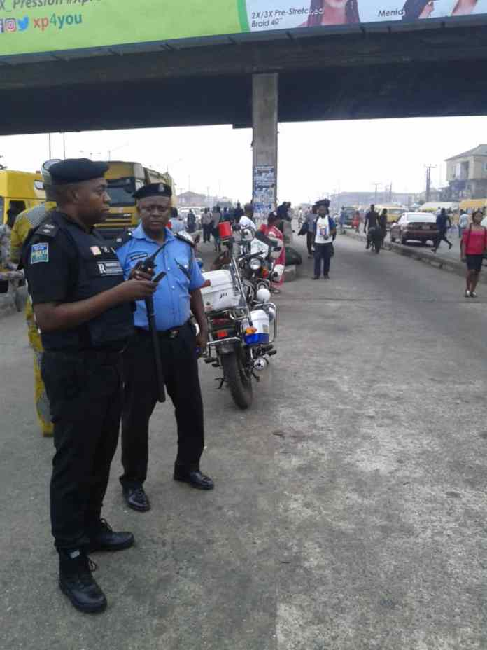 Police from Iyana-Ipaja division at the bus stop parading to access level of compliance as well as arrest defaulters