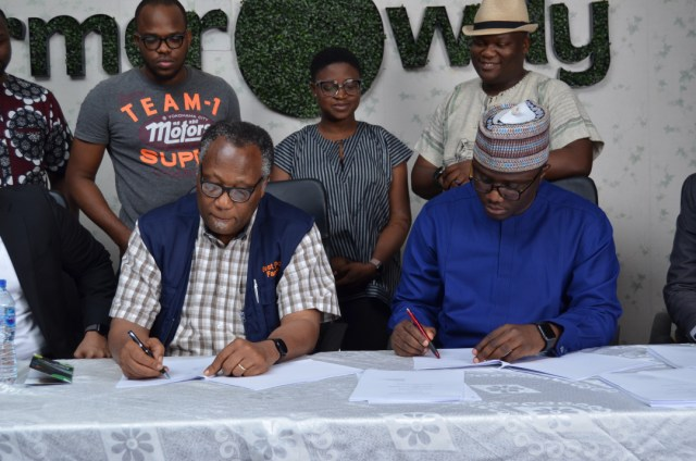 The Chairman, Best Foods L&P Limited, Mr. Emmanuel Ijewere and Founder and CEO of Farmcrowdy, Onyeka Akumah signing the acquisition deal at the Farmcrowdy office in Lagos, Nigeria