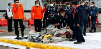 Military Recover Body Parts From Indonesian Plane Crash Site