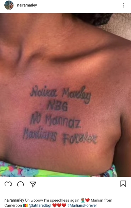 Singer Naira Marley Left Speechless As Female Fan Tattoos His Name On Her Chest