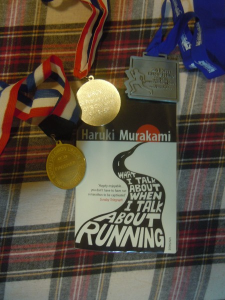 book with 3 of my race medals