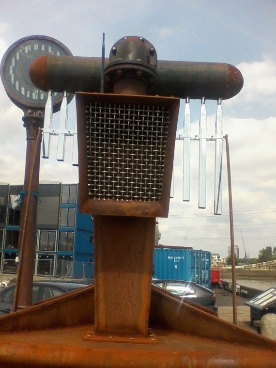 To the left of it is an instrument that reads the moon tides.