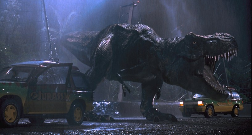 A T-Rex breaks loose from his caged habitat in Steven Spielberg's JURASSIC PARK (1993)