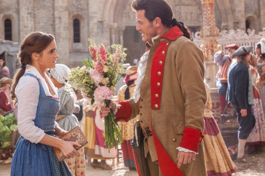 Emma Watson as Belle and Luke Evans as Gaston in BEAUTY AND THE BEAST (2017)