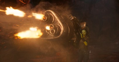 Zoe Saldana as Gamora, shooting a blaster, in GUARDIANS OF THE GALAXY, VOL. 2