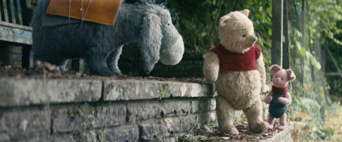 Brad Garrett as Eeyore, Jim Cummings as Pooh, and Nick Mohammed as Piglet in Disney's CHRISTOPHER ROBIN