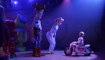 The voices of Tom Hanks (Woody), Annie Potts (Bo Peep), and Keanu Reeves (Duke Caboom) star in Pixar's TOY STORY 4 (2019)
