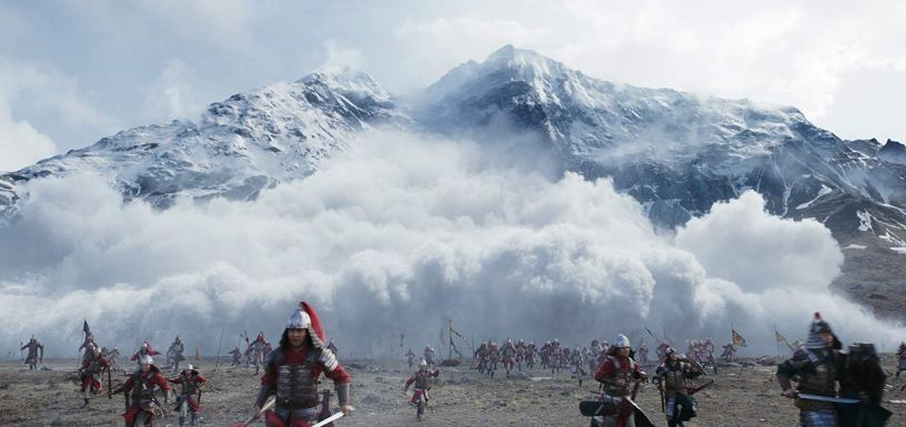 Warriors flee from an avalanche in Disney's live action remake of MULAN (2020)