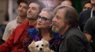 Mark Hamill, Carrie Fisher, and Oscar Isaac share a moment at a STAR WARS event.