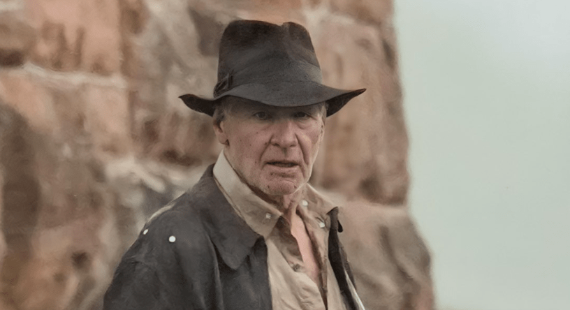 """Harrison Ford, in his iconic costume, is pock-marked with """"tracking dots"""" on his face and clothing while shooting a scene for INDIANA JONES 5 (2022)"""