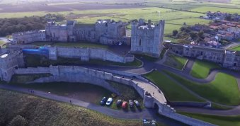 Exterior of Bamburgh Castle in Northumberland, UK, on location of the production for INDIANA JONES 5 (currently untitled)