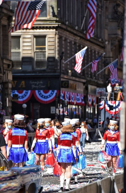 Patriotic cheerleaders are a part of the Apollo 11 ticker tape parade being re-created on the streets of Glasgow, Scotland for INDY 5.
