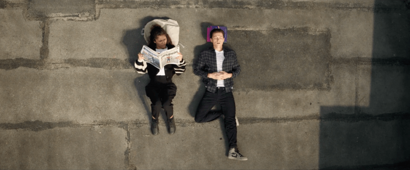 MJ and Peter Parker relax on a rooftop in SPIDER-MAN: NO WAY HOME (2021)