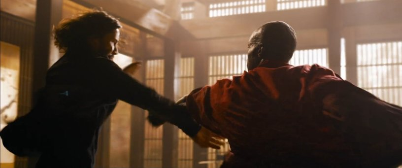 Neo (Keanu Reeves) fights in the martial arts training room against a new character played by Yahya Abdul-Mateen, in THE MATRIX RESURRECTIONS (2021)