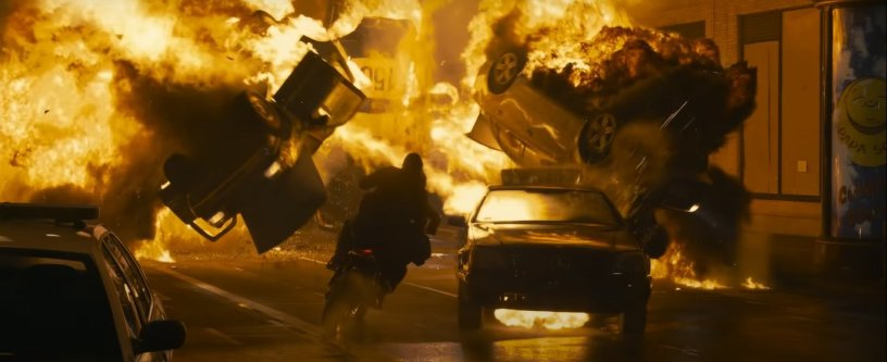 Neo (Keanu Reeves) and Trinity (Carrie-Anne Moss) escape through explosions in Neo fights off attackers and bullets in THE MATRIX RESURRECTIONS (2021)