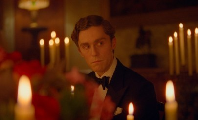 Prince Charles (Jack Farthing) at a Royal Family meal in the Princess Diana biopic SPENCER (2021)