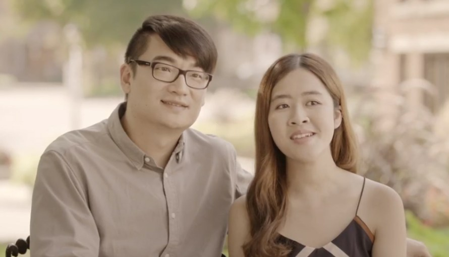 Image of young asian couple man is wearing glasses