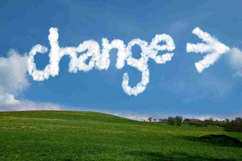 The word Change written against blue sky