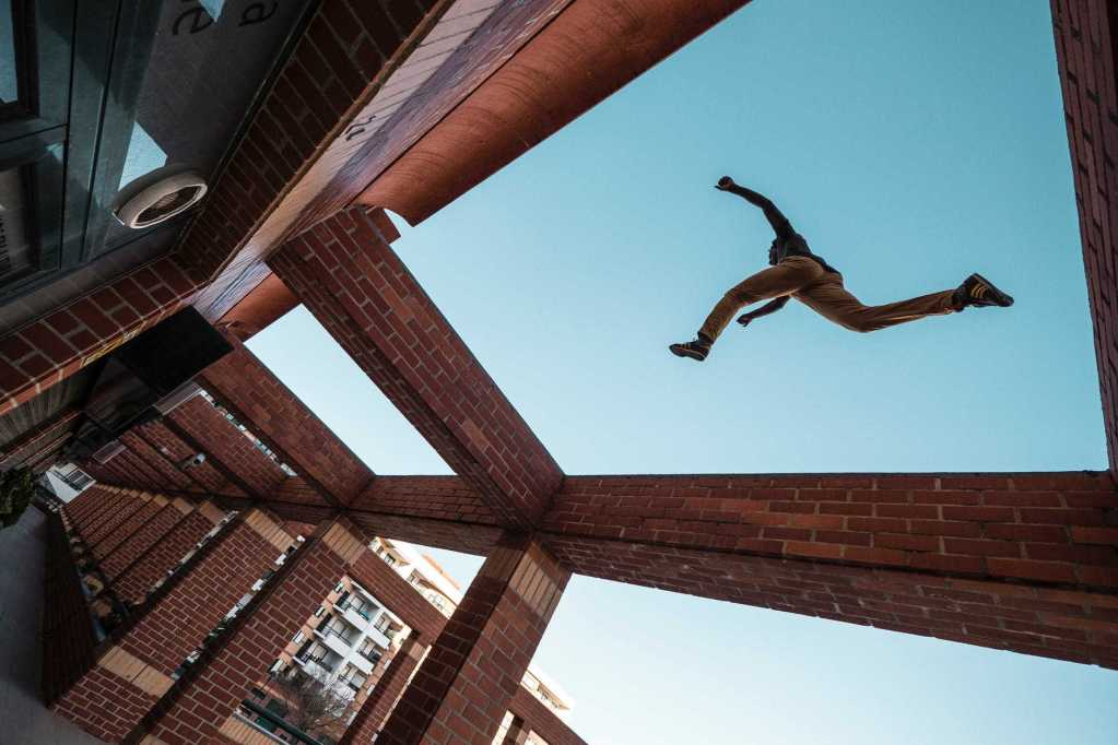 person jump while doing parkour