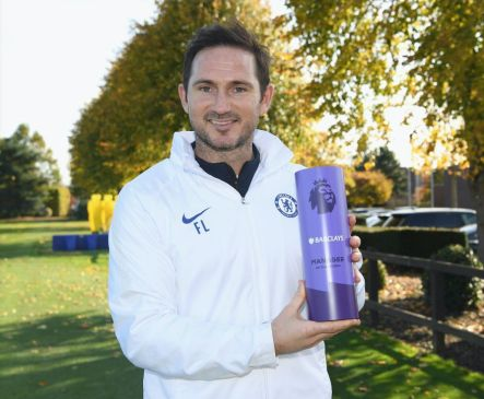 Lampard holding his Manager of the Month award for his work with Chelsea.