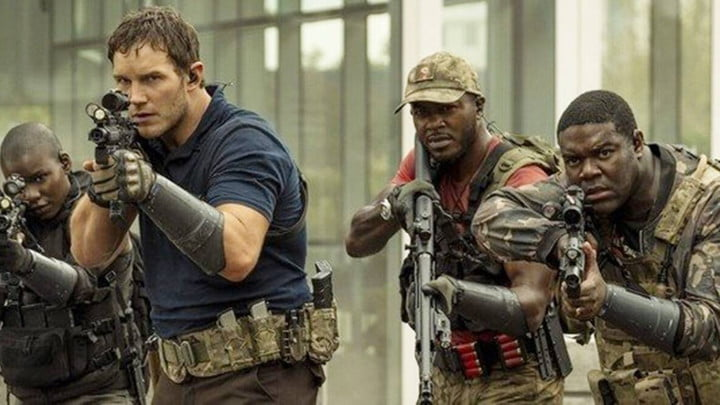 Chris Pratt and other actors in The Tomorrow War, advancing with assault rifles drawn.