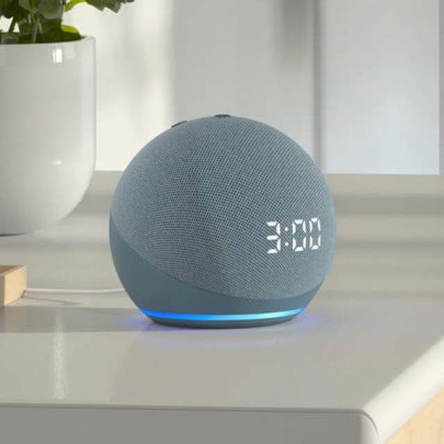 Amazon Echo Dot (4th Gen) with clock on clean table.