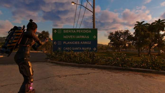 In Far Cry 6, Dani looks at a road sign.