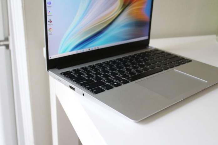 The Framework Laptop, open on a white table.