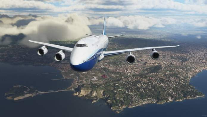 An airplane flies over a city in Microsoft Flight Simulator.