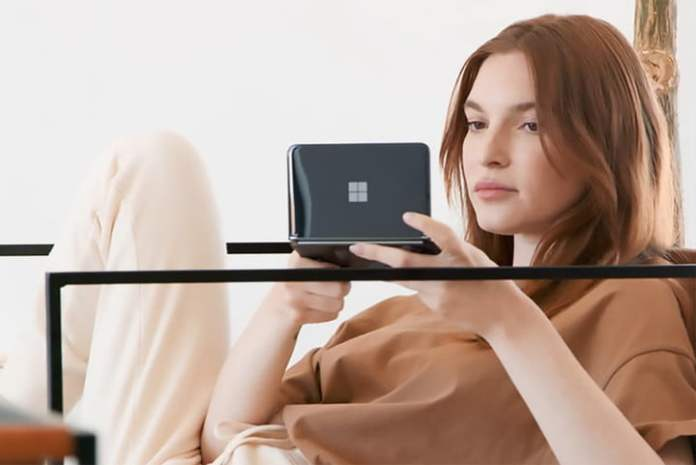 A person using a Microsoft Surface Duo 2.