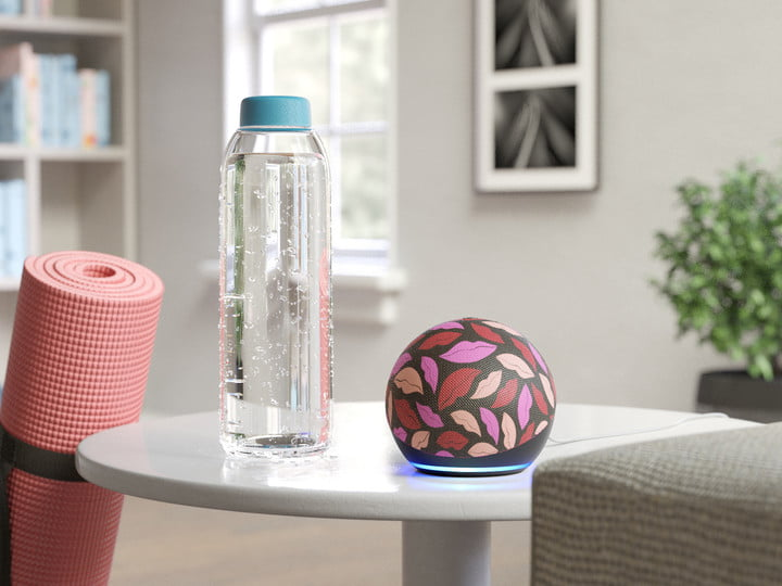 Amazon Echo Dot Diane von Furstenberg concept on a table with a water bottle nearby.