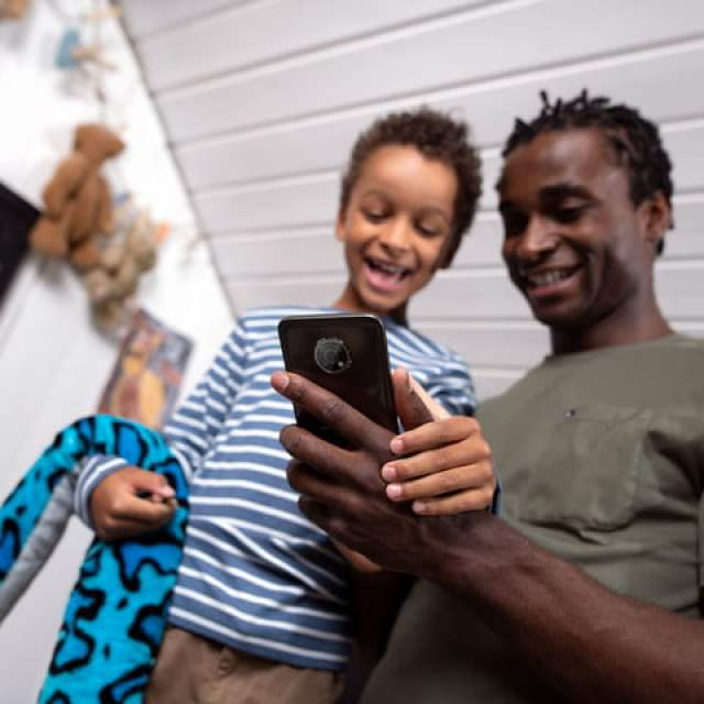 Image of family holding the Nokia G300.