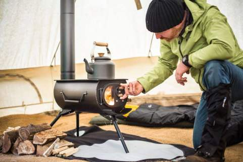 flipping through the manual cast iron cooking a portable wood stove
