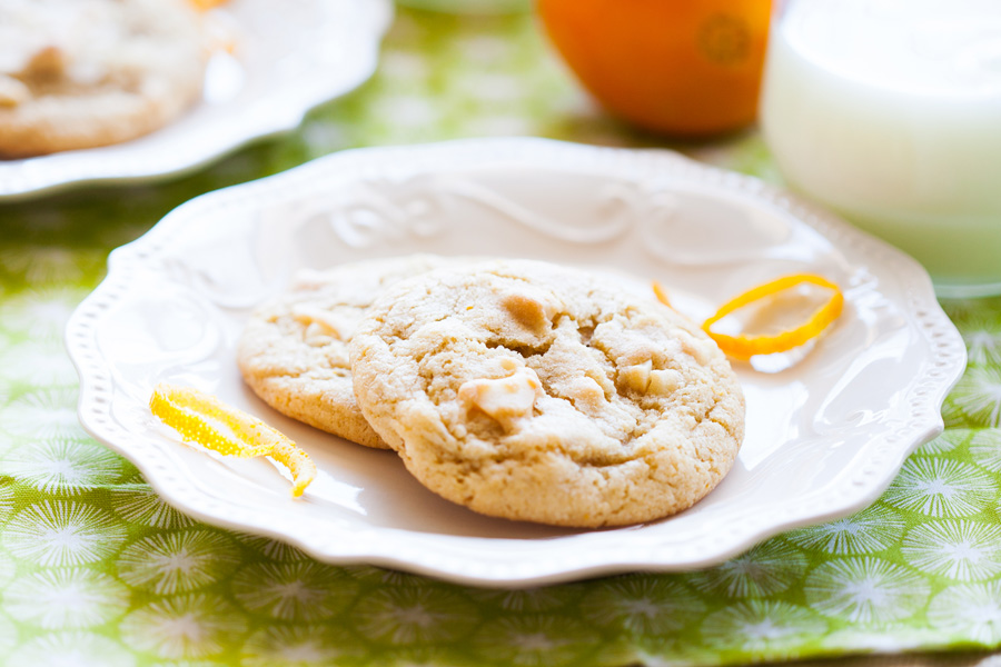 Orange White Chocolate Macadamia Nut Cookies are a new twist on the classic cookie we all love so well! With orange peel and orange essential oil (or extract), these cookies need to be in your cookie jar! Macadamia nut cookies, white chocolate cookies, orange cookies, Christmas cookies