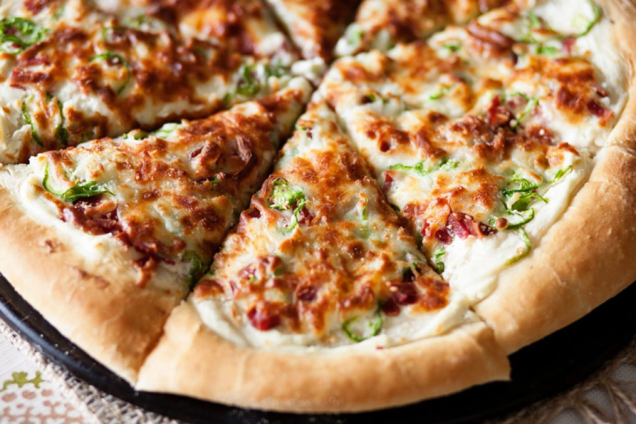 This Jalapeno Popper Pizza is the perfect pizza for dinner or an appetizer! Topped with jalapenos, bacon, onions and cheese, it's amazing! Perfect pizza dough, jalapeno pizza, pizza recipe
