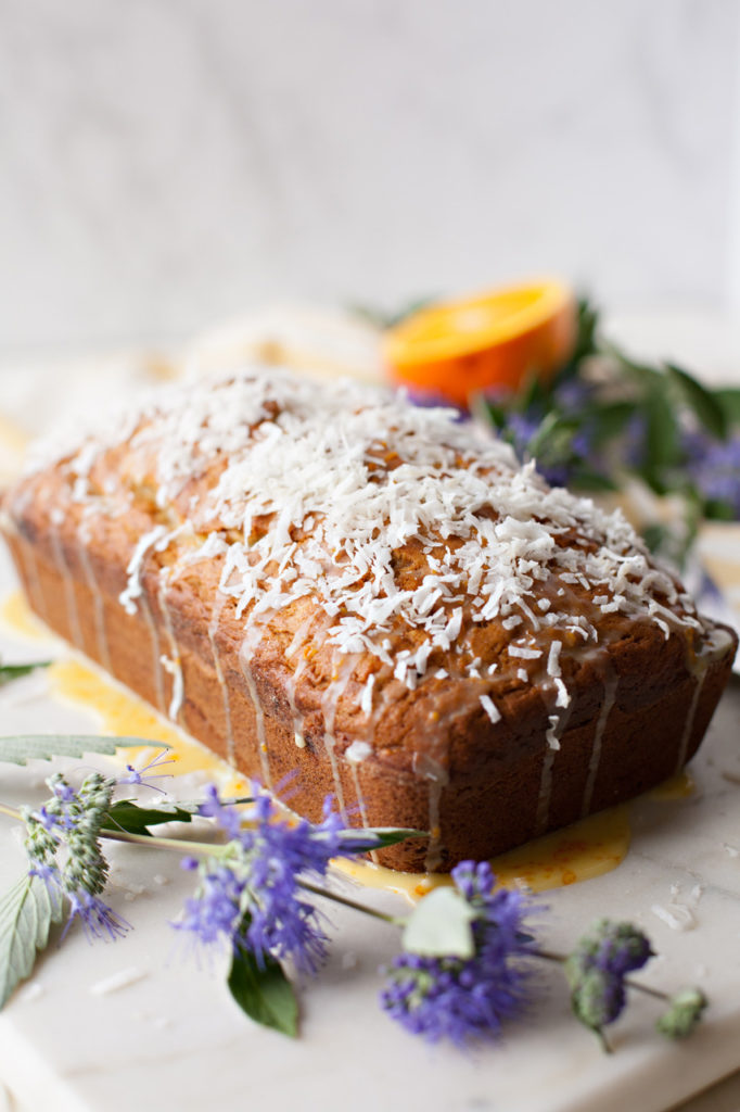 Banana Coconut Bread with Orange Glaze is moist, sweet, tender, and full of flavor! Perfect for any springtime menu!