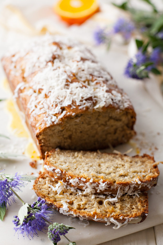 Make this tropical twist on a classic! Banana Coconut Bread with Orange Glaze is moist, sweet, tender, and full of flavor!