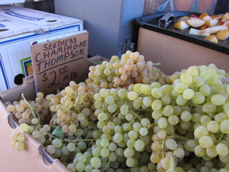 Buying grapes at the farmers market