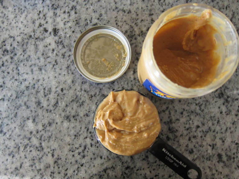 Measuring a cup of peanut butter