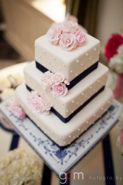 Tiered wedding cake with pink roses